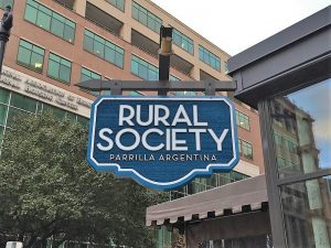 custom projecting storefront sign